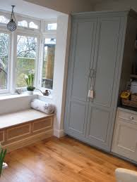 white built in window seat love adore the undressed bay window