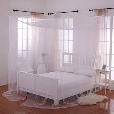 White Canopy Bed Curtains Photos Hgtv Traditional Bedroom With Tufted Headboard And Il