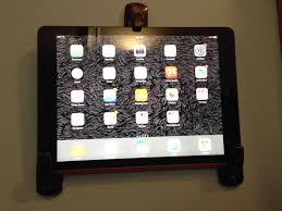stick on wall stick on coat hooks to hold up tablet on wall painted black to