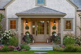 gray shingle house with covered porch cottage home exterior