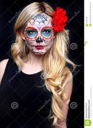 beautiful blonde woman with painted sugar skull art royalty free
