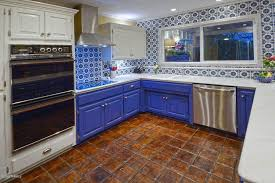 mexican tiles for kitchen backsplash contemporary kitchen with limestone counters raised panel in
