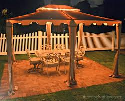 Globe Lights Patio by The Cape On The Corner Black And White Backyard Makeover