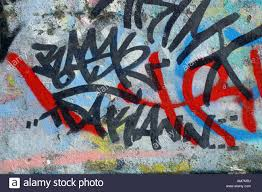 How To Graffiti With Spray Paint - graffiti is street art spray painting art or a crime stock photo