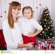Mother Daughter Christmas Ornaments Portrait Of Mother And Daughter With Christmas Tree At Home Stock