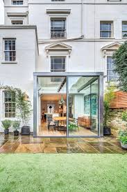 a cheerful home in london inspiring good temper architecture floor plans for houses commercial architects architect fees house architecture magazine house in london ourdoor garden glass encasing the dinning room white