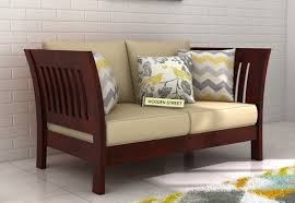 Two Seater Couch Buy Raiden 2 Seater Wooden Sofa Online In Mahogany Finish To Get