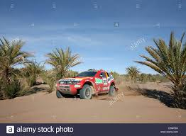 mitsubishi dakar french rallye pilot stephane peterhansel paces his mitsubishi