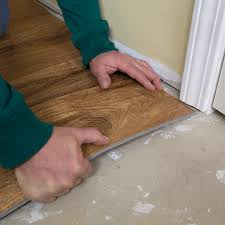 laying vinyl flooring on floor on how to install vinyl