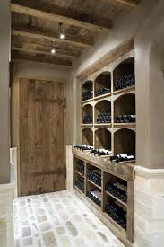 wine cellar table wine cellar only with warm tones and brick 2 chairs small table