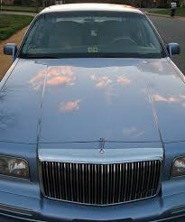 blue lincoln town car ornament and front grill car