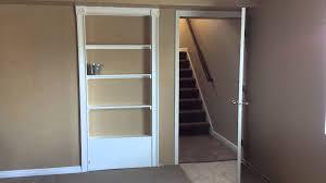 hidden bookcase door with bucket for latch youtube