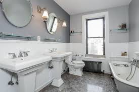 cottage 3 4 bathroom with wall sconce u0026 wainscoting in brooklyn