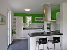 small modern open kitchen design with white cabinet and lighting