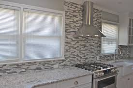 backsplash glass tile white kitchen cabinets blue glass