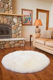 unique round area rugs for living room design with stone fireplace