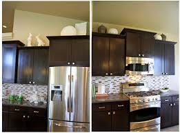ideas for top of kitchen cabinets how to decorate above kitchen cabinets shaweetnails modern decor