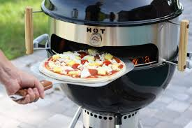 kettlepizza turns a kettle grill into an outdoor pizza oven