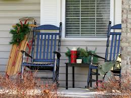 fall front porch decorating at the picket fence falling leaves