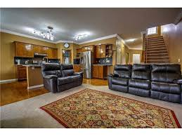 flooring basement design with leather recliner sofa and crescent