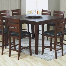 high top kitchen tables are a contemporary spin on the eat in monarch specialties largest bar pub tables sets collection the dark oak finish top grooved slat design and lazy susan feature make this dark oak veneer