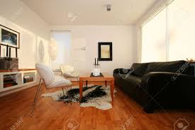 living room with leather sofa mirror on wall and photo