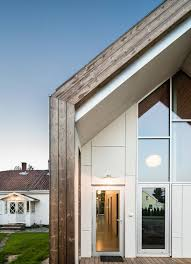 contemporary farmhouse link arkitektur wraps contemporary gabled extension with kebony