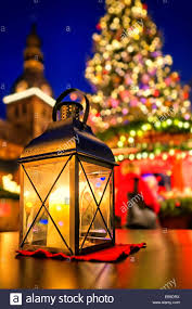 lantern at european christmas market in front of christmas tree