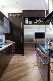 dark kitchen cabinets with white backsplash light granite grey