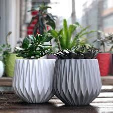 modern plant pots concrete and copper plant pots by geo fleur