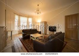 livingroom glasgow living room luxury home orange walls stock photo 32883421