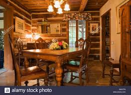 old wooden dining table chairs in dining room inside a 1976 stock