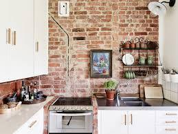 kitchens with brick walls exposed brick kitchen backsplash cream large tile flooring red
