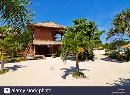tropical beach bungalow on ocean shore gili meno lombok
