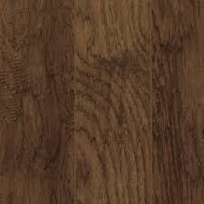 Laminate Flooring Door Jamb Medium Brown 2 Strip Hickory Plank With A Rustic Wood Grain