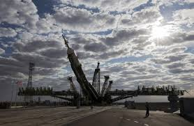 soyuz rocket bound for rendezvous with space station rolls out in