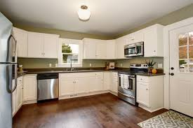 popular kitchen cabinet stains should you stain or paint your kitchen cabinets