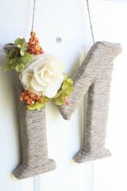 twine wrapped rustic wooden letters with crochet lace pearl flower