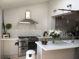 howdens burford stone kitchen with a white corian worktop white howdens burford stone kitchen with a white corian worktop white sunbway tiles and grey grout
