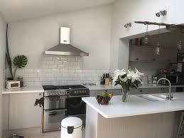 howdens burford stone kitchen with a white corian worktop white