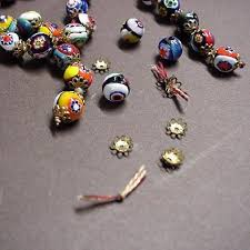 bead necklace bracelet images Knotted jewelry repair necklaces pearls stones jpg
