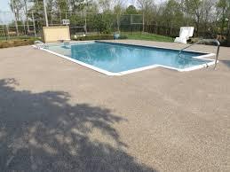 stamped concrete compared to graniflex coating slate pool decks