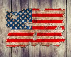United Staes Flag Usa Flag In Form Of Torn Vintage Paper On Wooden Background