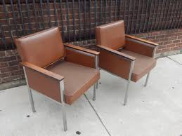 pair of vintage mid century office chairs in brown by all steel