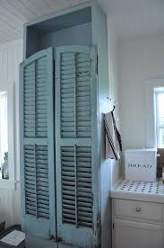 vintage window shutters repurpose tip junkie love the old shutters painted aqua for pantry doors i would have