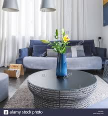 Big Sofa by Round Coffee Table In Living Room With Big Sofa And Pendant Lamps