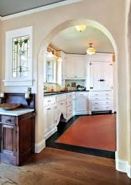 classic white kitchen for a 1920s tudor modern refrigerators