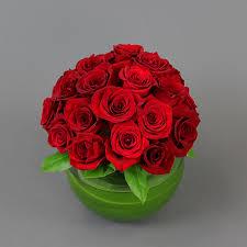 dozen roses two dozen roses in glass sphere field of flowers