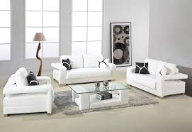 white leather sofa with arms and glass top table for small living