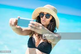 Take A Selfie Man Wearing Straw Hat And Sunglasses Taking A Selfie Stock Photo